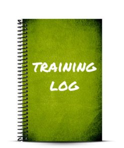green journal cover with training log written on it