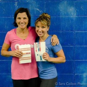 Athletes with their fitness journals