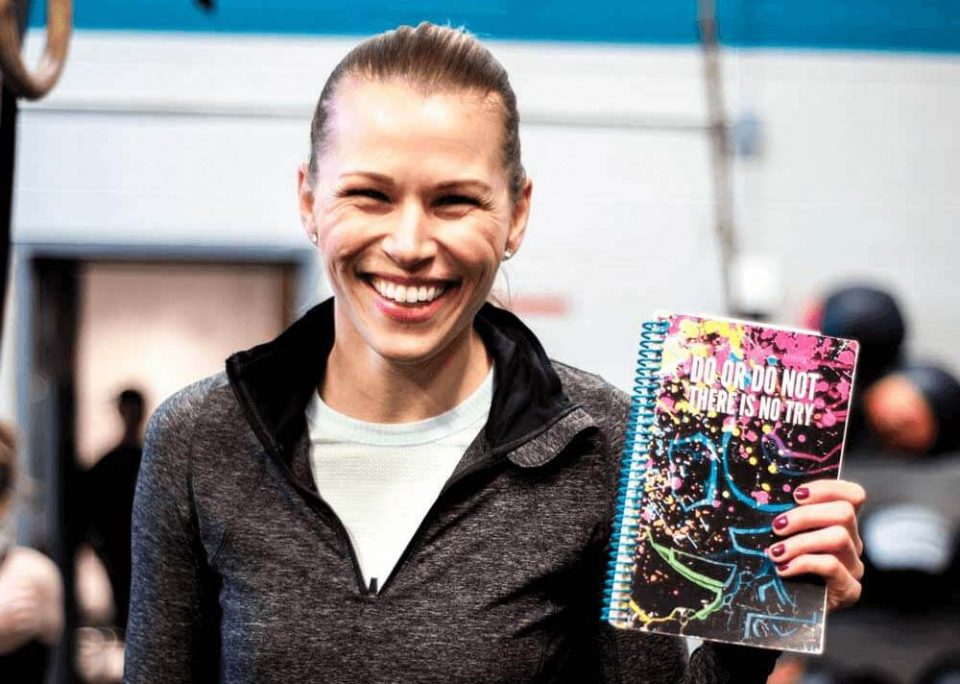 Smiling girl with her WOD journal