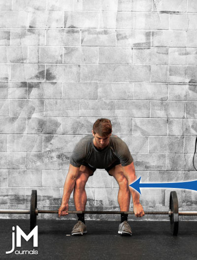 blue arrow pointing to the knee position of a male performing a deadlift with a barbell