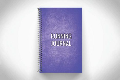 Purple running journal for tracking distance and running workouts on gray background