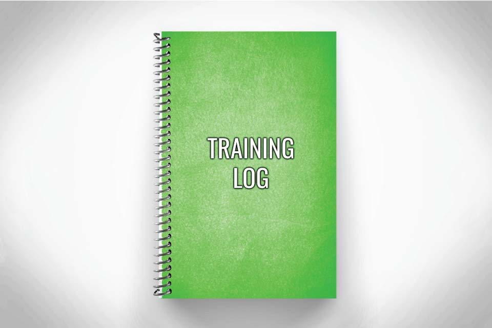 Green training log for workout tracking on grey background