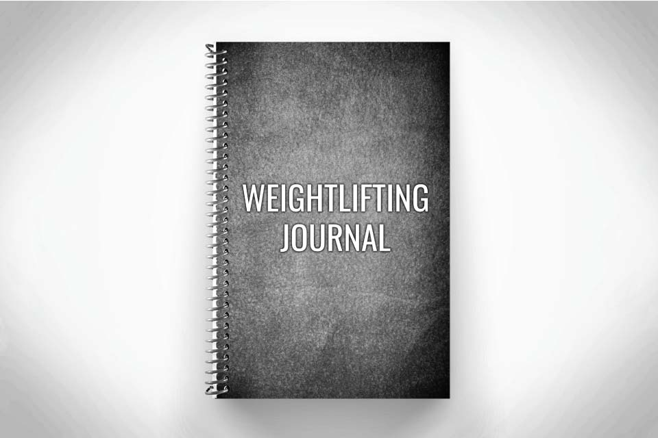 Black and Grey weightlifting journal for tracking performance and workouts on gray background