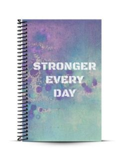 Blue and purple fitness journal with stronger every day quote on front