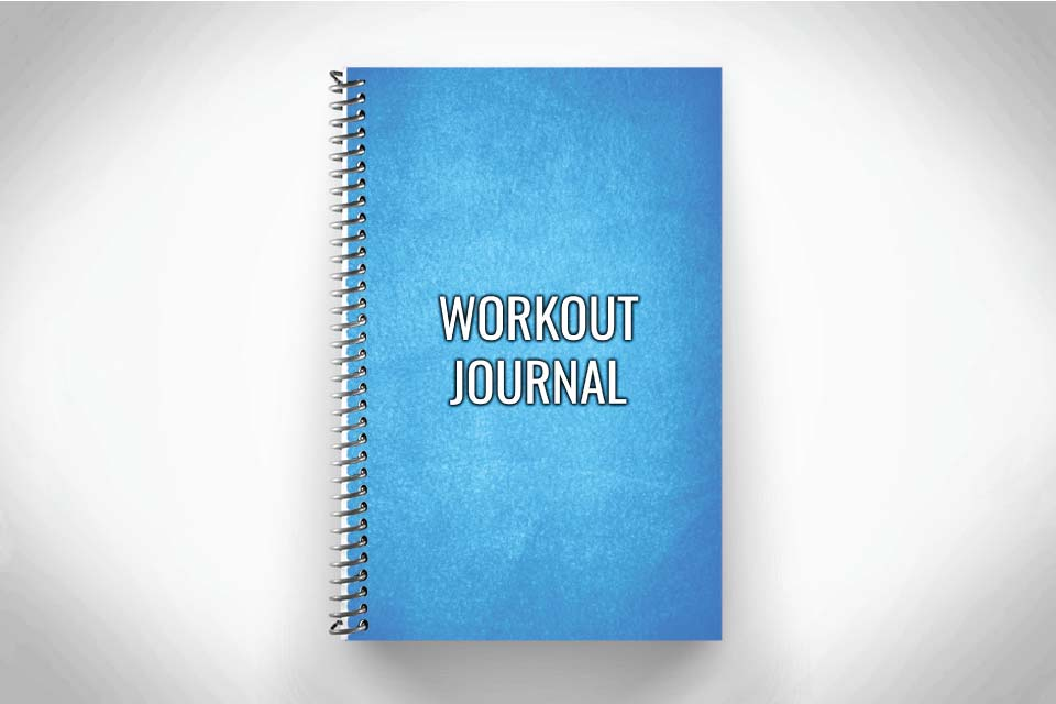 Blue Workout Journal on gray background