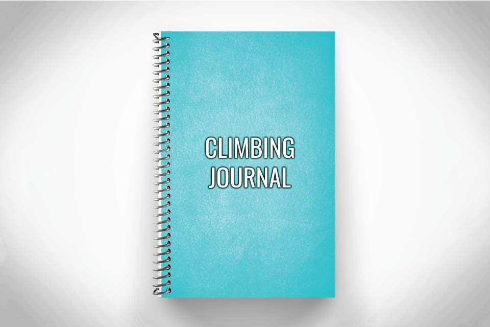 teal rock climbing workout journal and training log on gray background