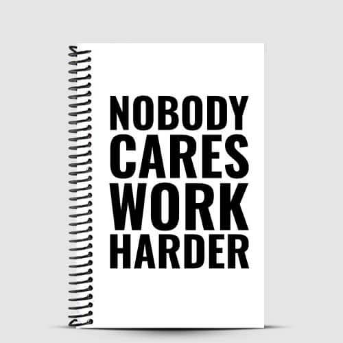 white and black fitness journal with nobody cares work harder quote