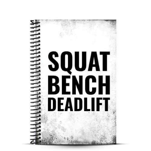 squat bench deadlift fitness motivation quote on distressed white journal cover