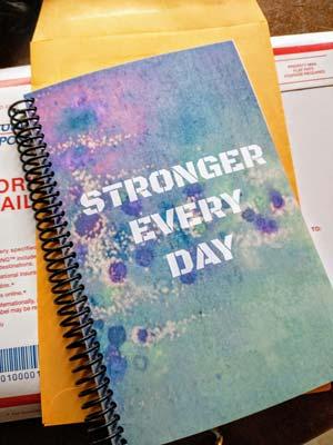 Angela purple and blue crossfit wod journal on envelope